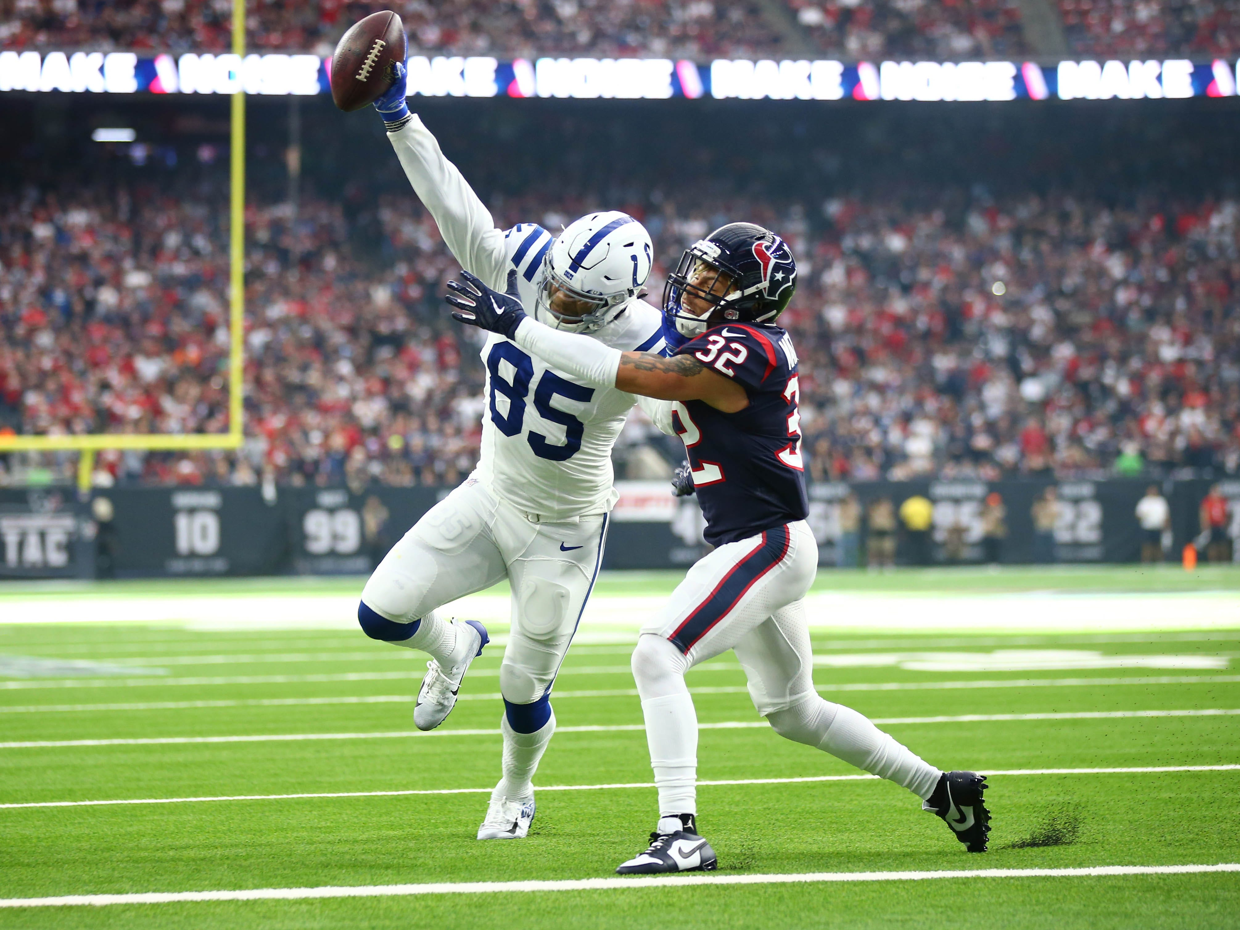 Indianapolis Colts tight end Eric Ebron (85) scores a touchdown past Houston Texans free safety Tyrann Mathieu (32) in the first quarter in a AFC Wild Card playoff football game at NRG Stadium.