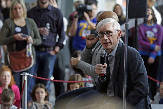 Gov.-elect Tony Evers sits on a stage as he speaks to children Sunday at the Fox Cities Performing Arts Center in downtown Appleton.
