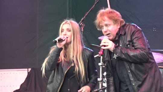 Eddie Money on stage with his daughter, Jesse, during a 2017 gig.