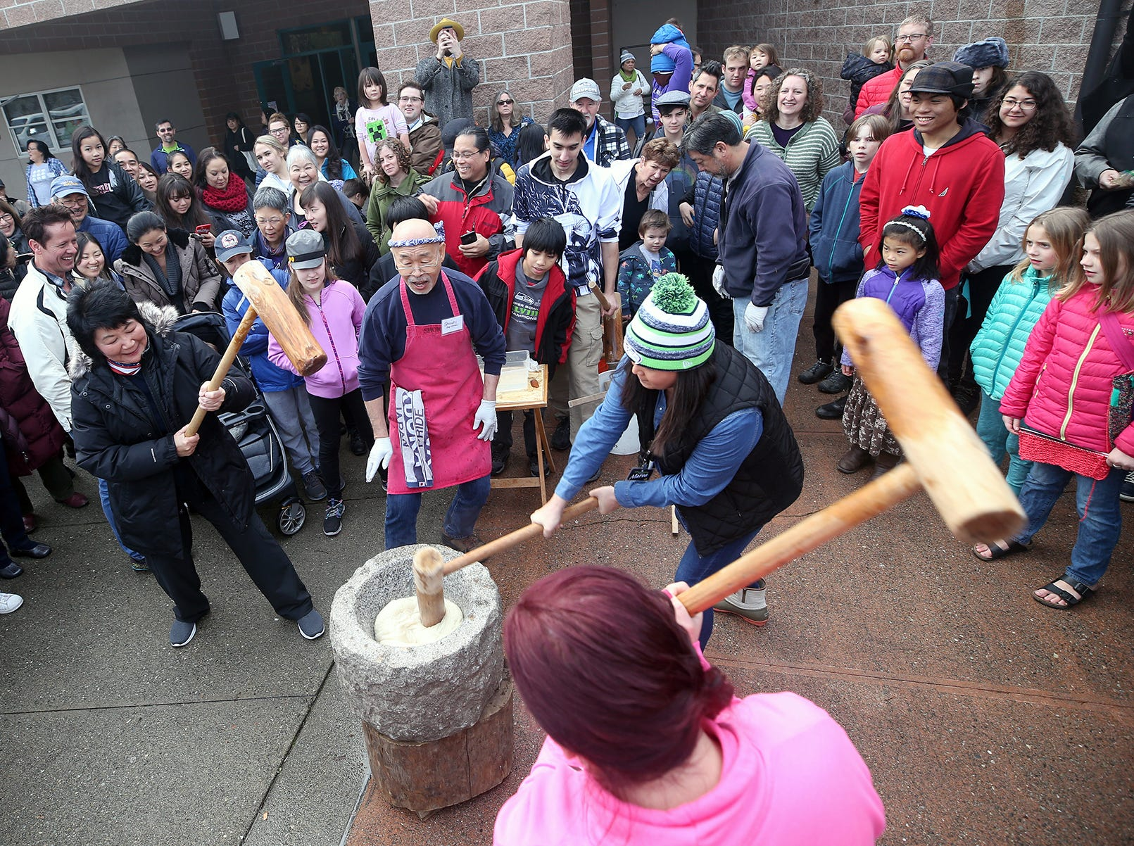 The 30th anniversary of Bainbridge Island's Japanese-American Mochi Tsuki celebration was held at an new location at the Woodward Middle School on Saturday, January, 5, 2019. Mochi Tsuki is a traditional Japanese New Year's tradition of steaming rice and pounding into a rice cake.