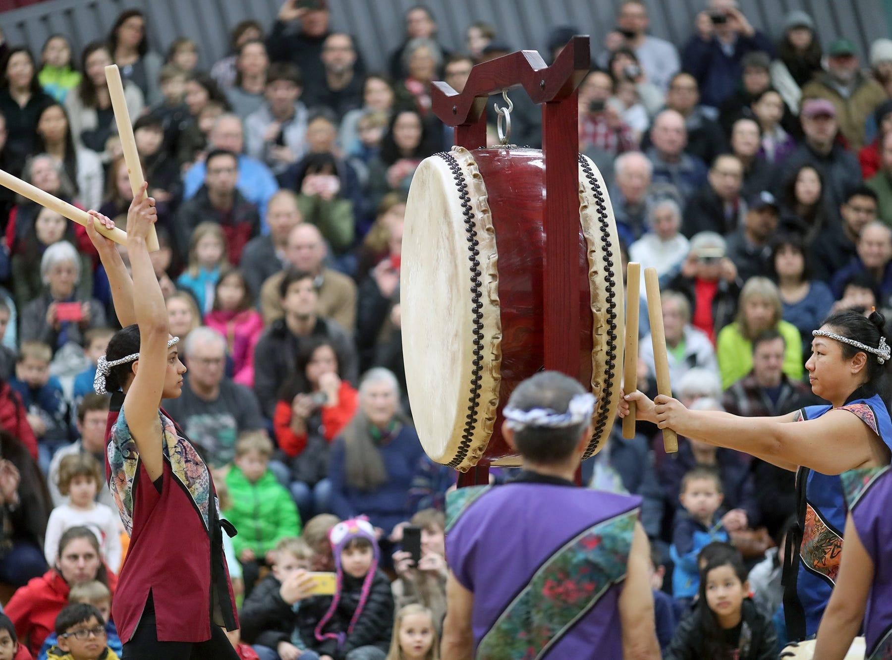 The 30th anniversary of Bainbridge Island's Japanese-American Mochi Tsuki celebration was held at an new location at the Woodward Middle School on Saturday, January, 5, 2019. Mochi Tsuki is a traditional Japanese New Year's tradition of steaming rice and pounding it into a rice cake. The Seattle Kokon Taiko drummers perform to a capacity crowd in the gym.