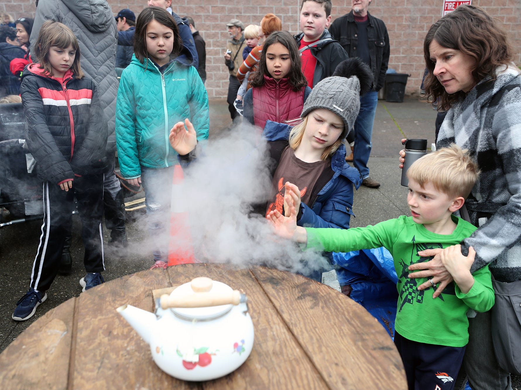 The 30th anniversary of Bainbridge Island's Japanese-American Mochi Tsuki celebration was held at an new location at the Woodward Middle School on Saturday, January, 5, 2019. Mochi Tsuki is a traditional Japanese New Year's tradition of steaming rice and pounding it into a rice cake.