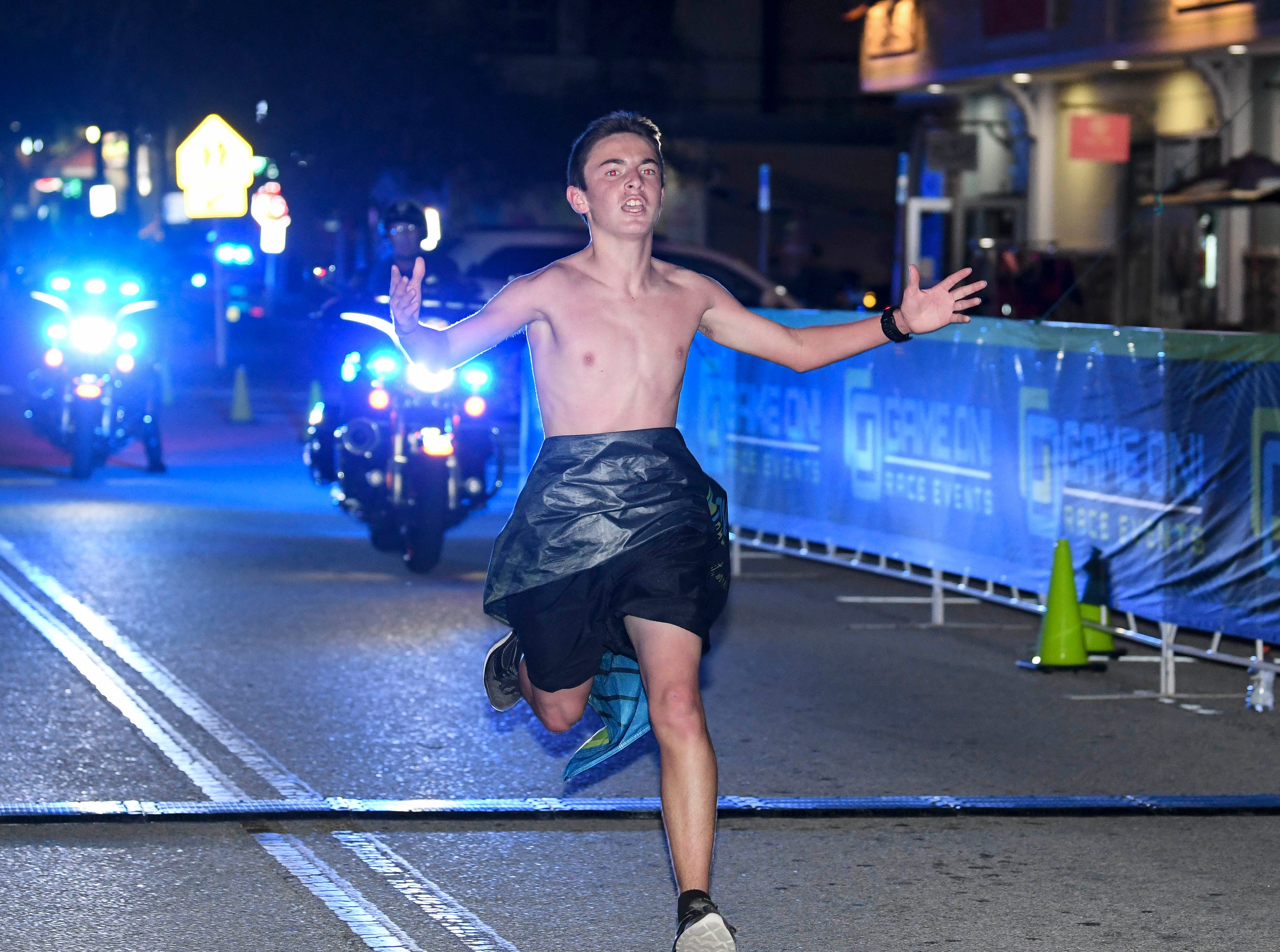 Logan Chapman of Cocoa is the overall winner of  the inaugural Game On Run for Responders 5K Run/Walk in Cocoa Village. Proceeds from the event benefit Survive First.