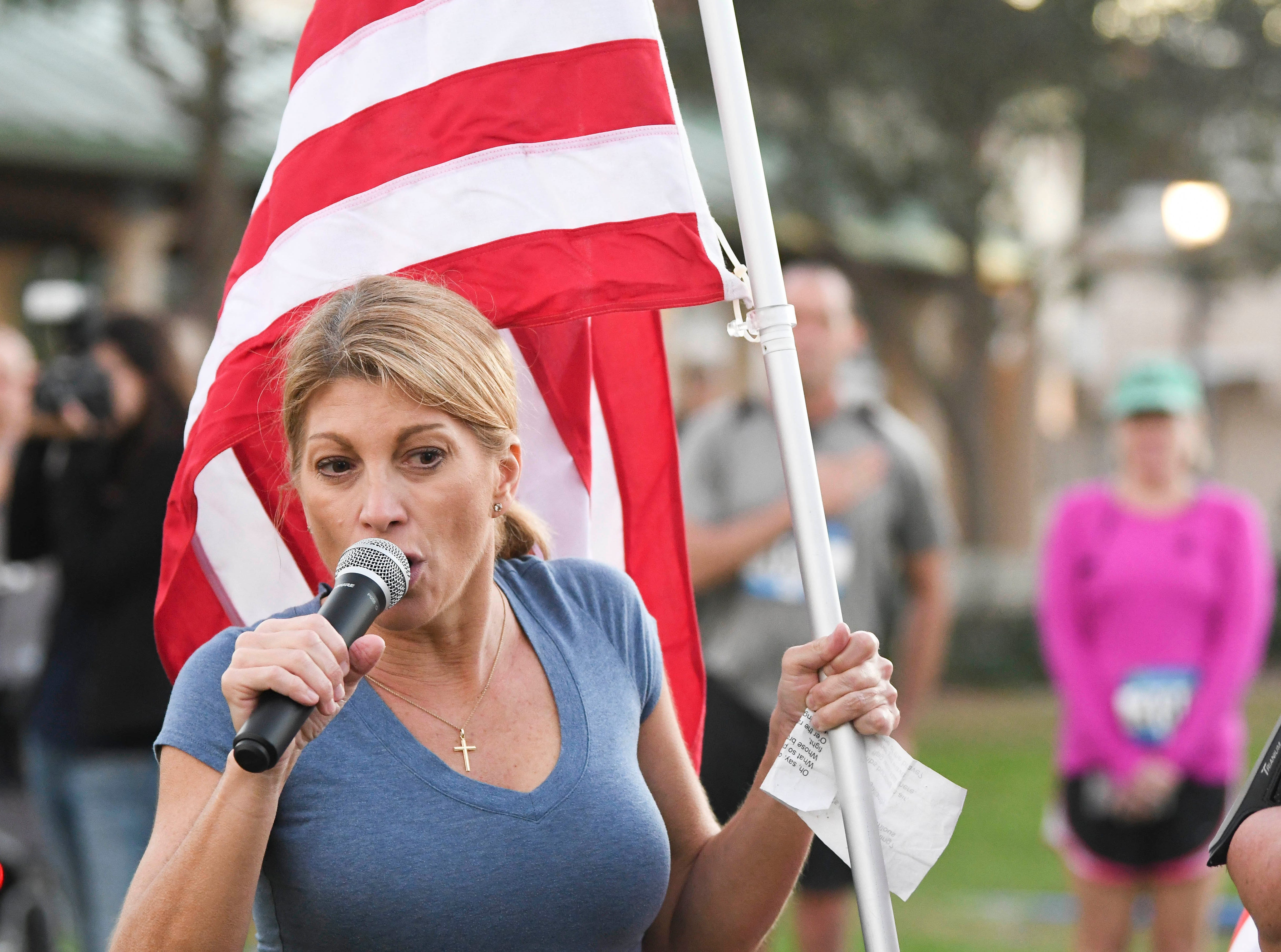 Donna Bollinger sings the National Anthem before the start of the inaugural Game On Run for Responders 5K Run/Walk run through the streets of Cocoa Village.  Proceeds from the event benefit Survive First.