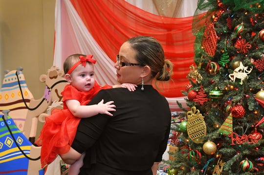 7 month old Nina Widner with her godmother, Samantha Navario. The United Third Bridge Puerto Rico Relief Fund held a Three Kings Celebration, a Latino family tradition for Christmas at The Crane Creek Center /The BACK Center in Melbourne on Sunday, Jan.6. The event included the many families who were victims of Hurricane Maria, and were forced to relocate. See the video at www.floridatoday.com.