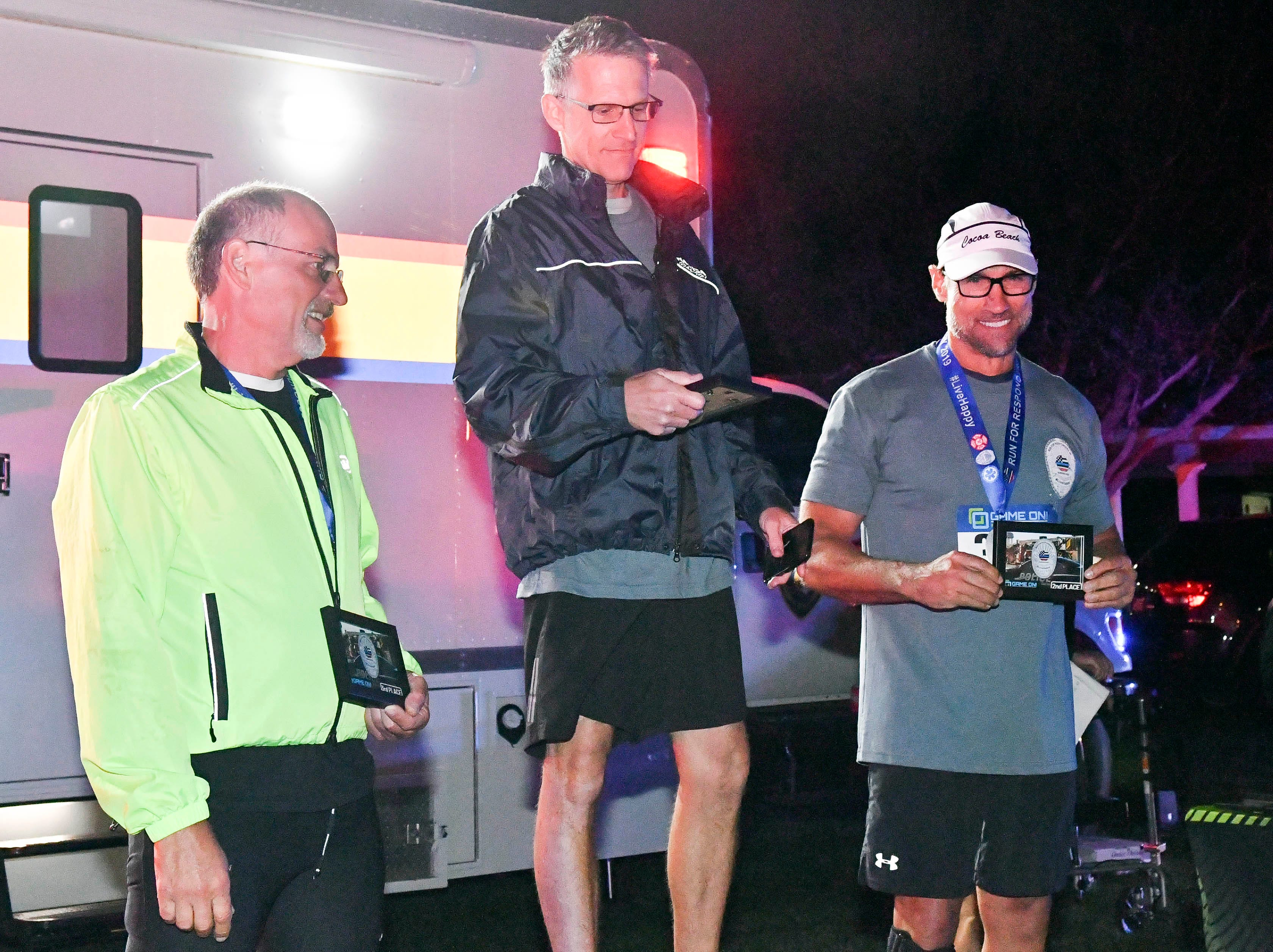 Participants in the inaugural Game On Run for Responders 5K Run/Walk receive their awards during Saturday's event.  Proceeds from the event benefit Survive First.