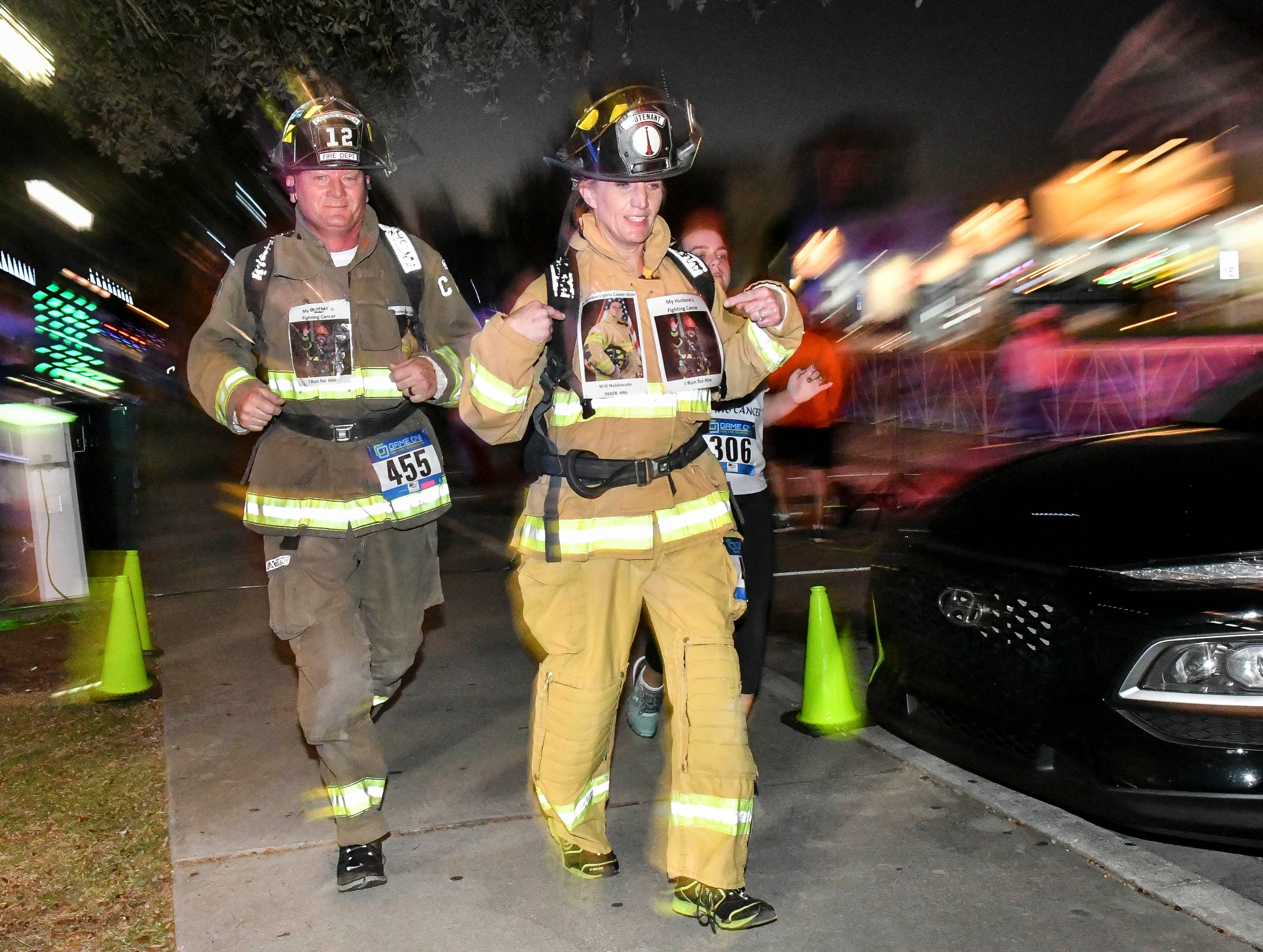 First responders in full gear run the course in the inaugural Game On Run for Responders 5K Run/Walk run through the streets of Cocoa Village Saturday.  Proceeds from the event benefit Survive First, a nonprofit that aids responders and family members suffering with mental health issues.