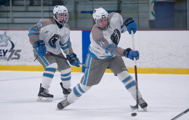 South Burlington's Rees Baker fires in a first-period power play goal against Mount Mansfield during Saturday night's boys hockey game at Cairns Arena in South Burlington on Jan. 5, 2019.