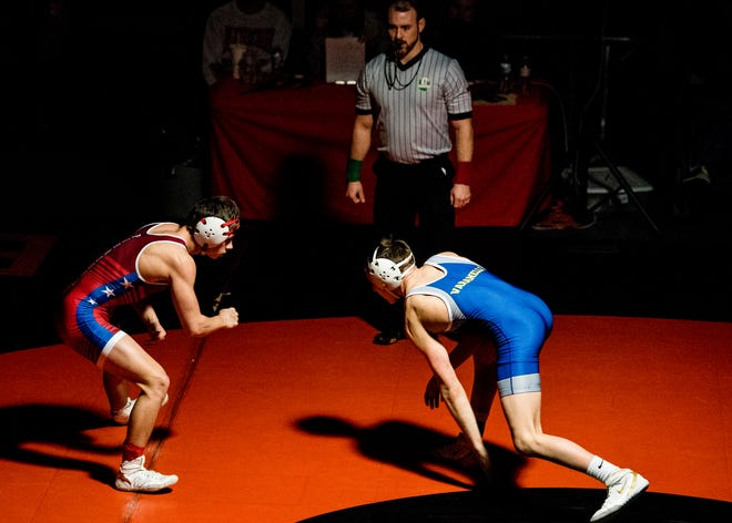 Zane Trace senior Jordan Hoselton wrestled under the Beavercreek championship spotlight Saturday at Beavercreek High School. Hoselton took second in the 132-pound weight class against Olentangy's Nick Varanelli.