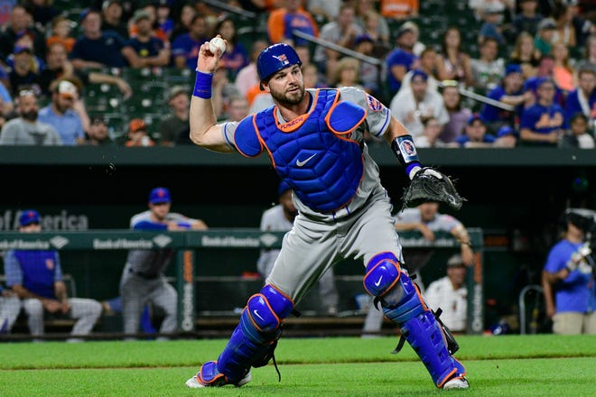 New York Mets catcher Kevin Plawecki (26) throws to first base for the force out of Baltimore Orioles center fielder Cedric Mullins (not pictured) during the fifth inning at Oriole Park at Camden Yards.
