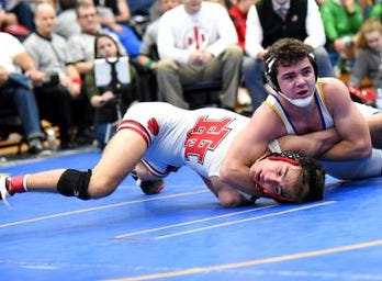 Madeira's Jackson Hugentobler picks up a 10-3 victory over Jaden Anderson of Indian Hill and takes home the 145lb title for the home team at the 2019 Bob Kearns Madeira Invitational, January 5, 2019.