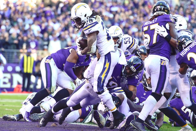 Los Angeles Chargers running back Melvin Gordon (28) runs for a fourth quarter touchdown  against the Baltimore Ravens in a AFC Wild Card playoff football game at M&T Bank Stadium.