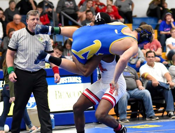 John Mark Williams of Indian Hill spins David Pride of Clermont Northeastern to the mat on his way to a pinfall win to claim the 170lb class title at the 2019 Bob Kearns Madeira Invitational, January 5, 2019.
