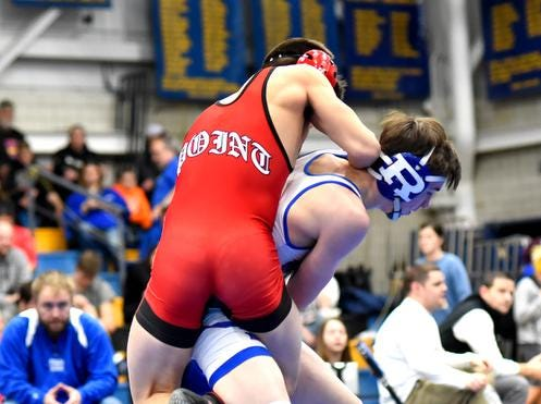 Colton Robins of Reading takes George Smith Jr. for a ride while wrestling in the 132lb class title match at the 2019 Bob Kearns Madeira Invitational, January 5, 2019.