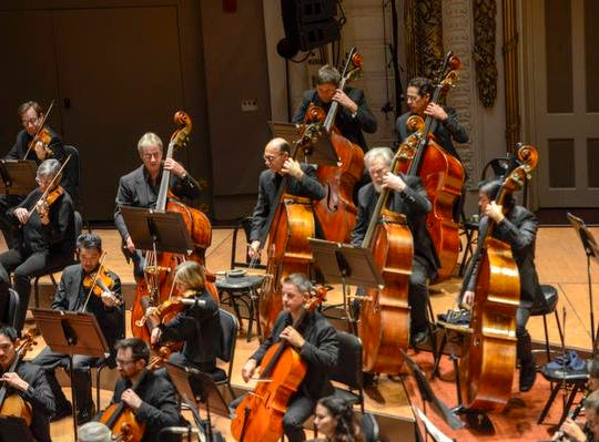 "A night out at Music Hall with the CSO.  Guest conductor Karina Canellakis returned to Music Hall to lead the CSO in a ""Romantic Rachmaninoff"" program that featured pianist Kirill Gerstein performing the composer's Piano Concerto No. 3. The string section of the CSO."
