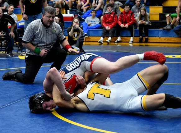 Joshua Chapman works to escape the hold of Norwood's Greg Melton as they grapple in the 160lb class 3rd place matchup at the 2019 Bob Kearns Madeira Invitational, January 5, 2019.