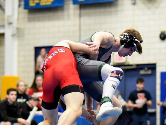 A mat's eye view sees Pierce Taylor of McNicholas looking to pull his Point Pleasant opponent to the mat in the 126lb class championship match at the 2019 Bob Kearns Madeira Invitational, January 5, 2019.