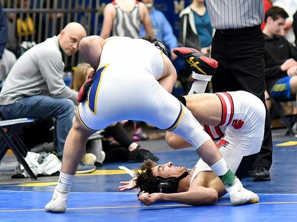Jaden Anderson of Indian Hill grimaces in discomfort while grappling in the 145lb class championhip at the 2019 Bob Kearns Madeira Invitational, January 5, 2019.
