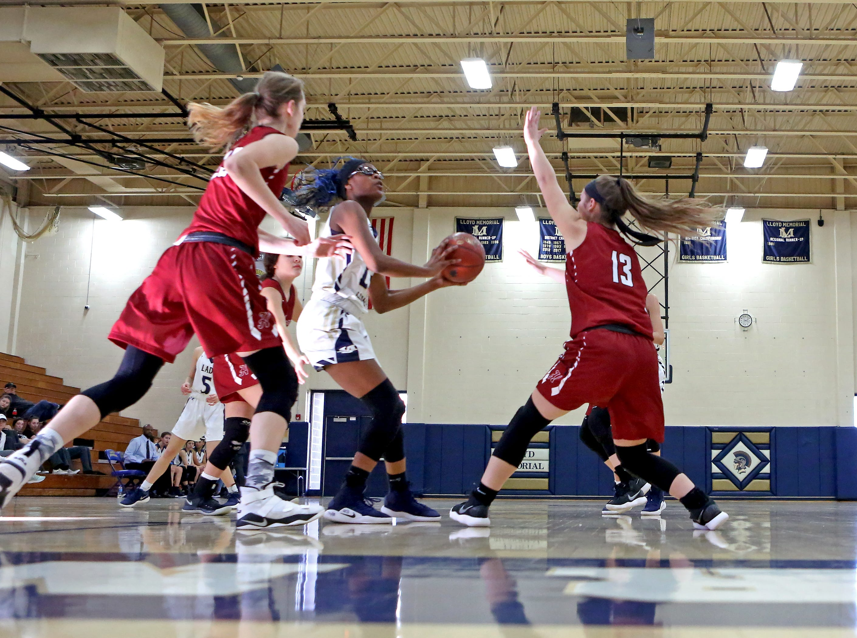 Lloyd forward Jayla LaBordeaux attacks the basket through the Henry County defense. Lloyd defeated Henry County 43-39.