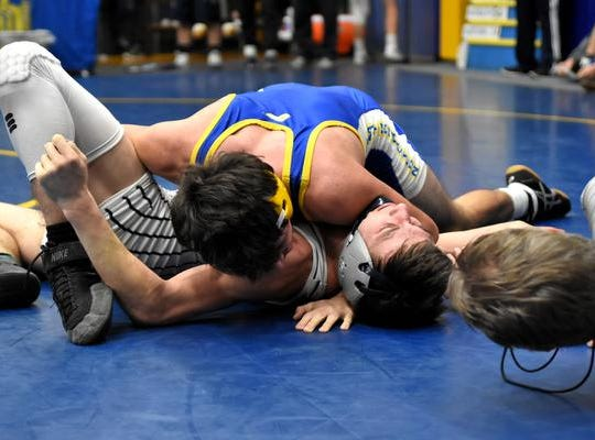 Tyler Conley of Clermont Northeastern scores a 16-12 3rd place win over Bkanchester's Johnny Schirmer in the 138lb class at the 2019 Bob Kearns Madeira Invitational, January 5, 2019.