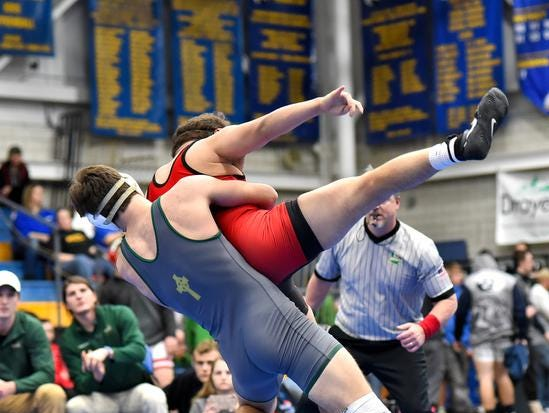 Ryan Gear of McNicholas tosses his Point Pleasant WVa opponent to a 6-5 win in the 182lb championship match at the 2019 Bob Kearns Madeira Invitational, January 5, 2019.