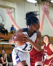 Lloyd forward Jayla LaBordeaux gets an offensive rebound. Lloyd defeated Henry County 43-39.