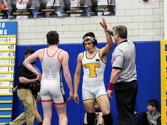 Joshua Chapman of Taylor has his hand raiseed in victory in the 160lb, 3rd place mtchup at the 2019 Bob Kearns Madeira Invitational, January 5, 2019.