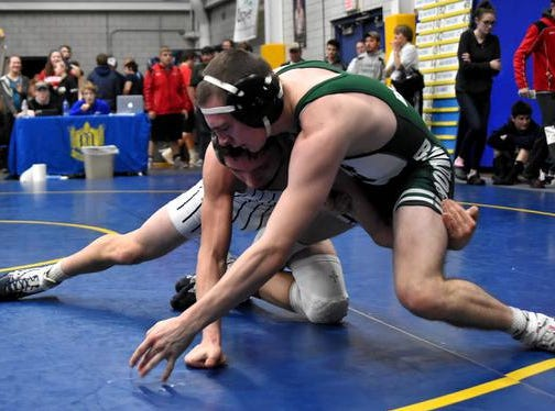 Elijah Waters of Batavia and Gage Huston of Blanchester battle for 3rd place in the 145lb class at the 2019 Bob Kearns Madeira Invitational, January 5, 2019.