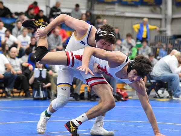 Jackson Hugentobler of Madeira drives Jaden Anderson of Indian Hill to the mat in the 145lb class title match at the 2019 Bob Kearns Madeira Invitational, January 5, 2019.