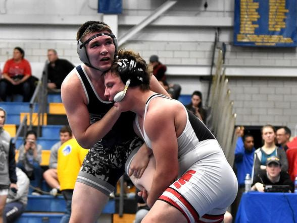 Nathan Berger of Indian Hill and Steven Latchford of Blanchester battle in the 182lb class, 3rd place match at the 2019 Bob Kearns Madeira Invitational, January 5, 2019.