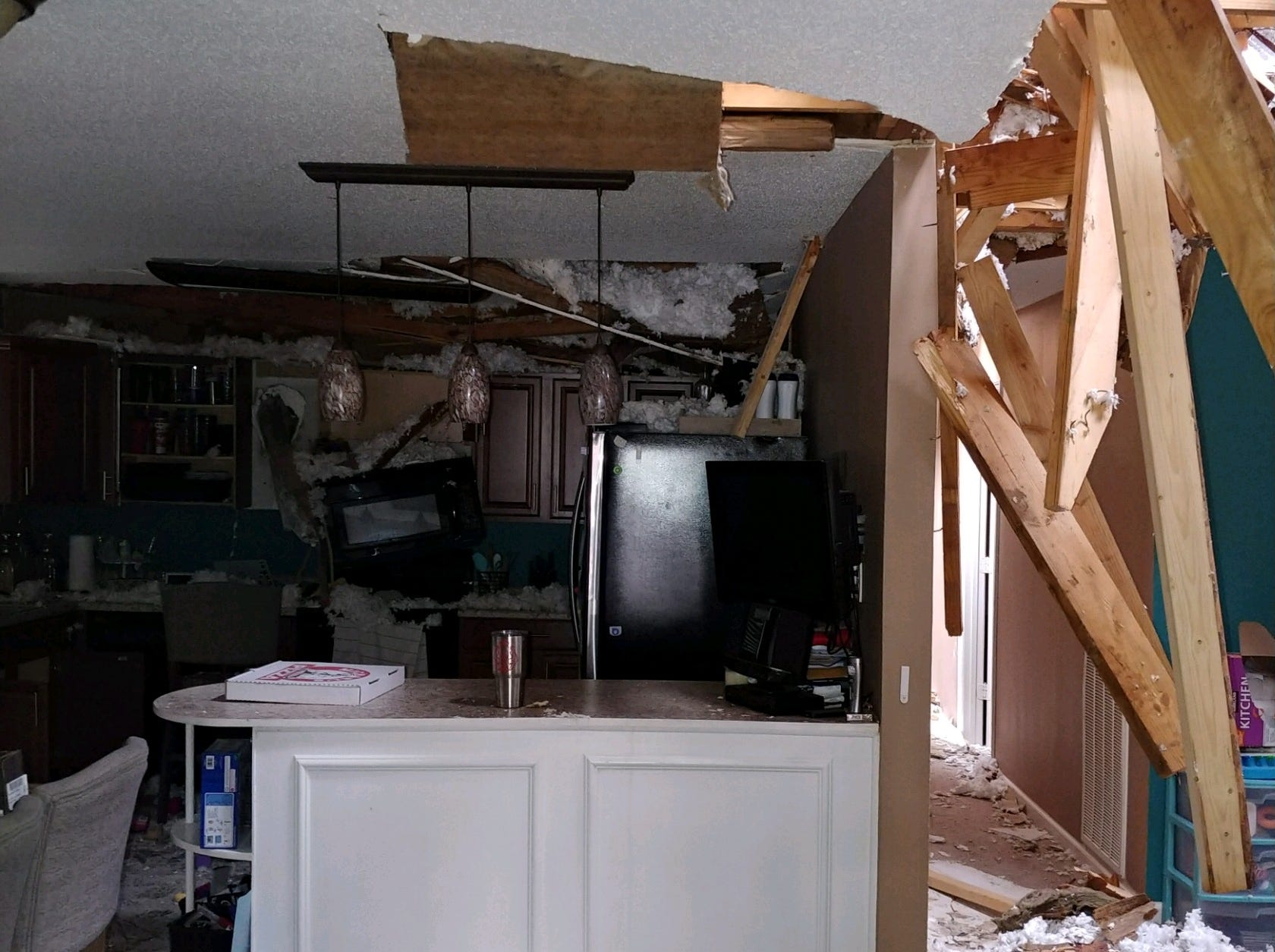 Damage to the Tinsley family home on Hickory Grove Blvd. in Clarksville after a tree smashed into it on New Year's Eve.