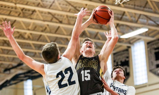 Watchung Hills' Jack Dwyer goes to the basket as Immaculata's Dan Johnson and Kevin Ford defend during the first half on Saturday, Jan. 5, 2018 at Immaculata.