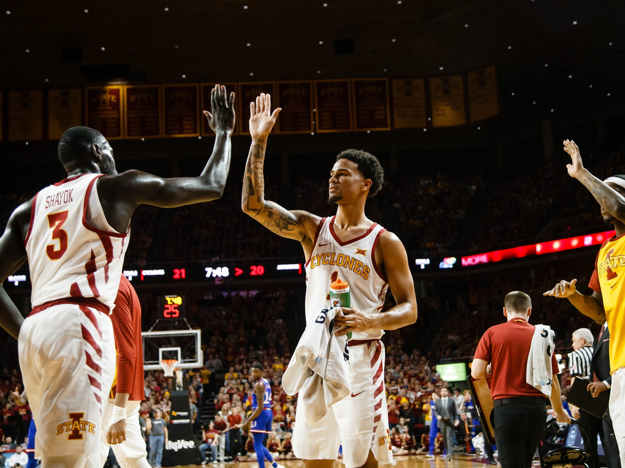 Iowa State's Marial Shayok (3) and Iowa State's Nick Weiler-Babb (1) high five during the first half of their basketball game on Saturday, Jan. 5, 2019, in Ames. Iowa State would go on to win 77-60.