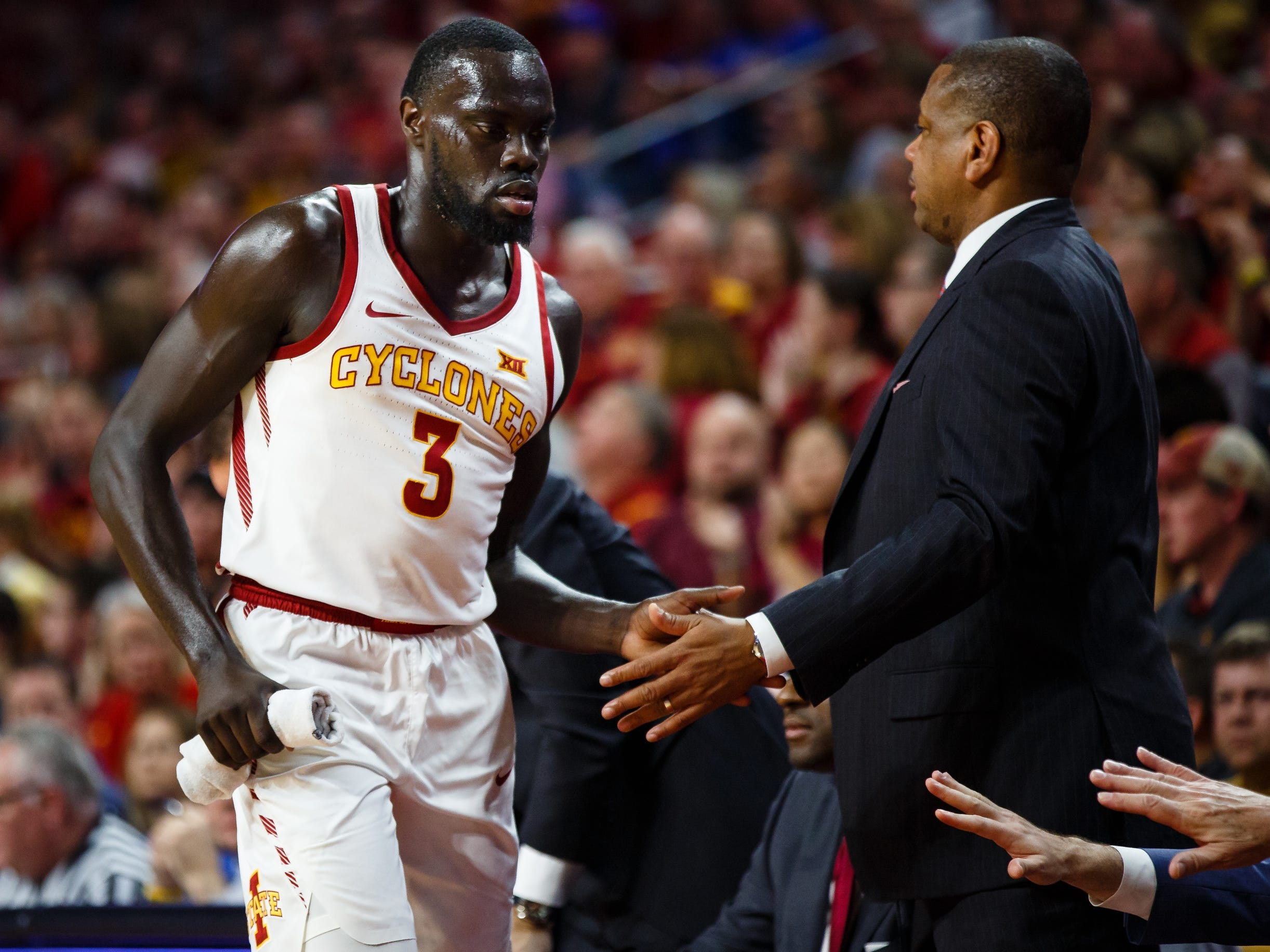 Iowa State's Marial Shayok (3) gets high fives on the bench during the first half of their basketball game on Saturday, Jan. 5, 2019, in Ames. Iowa State would go on to win 77-60.