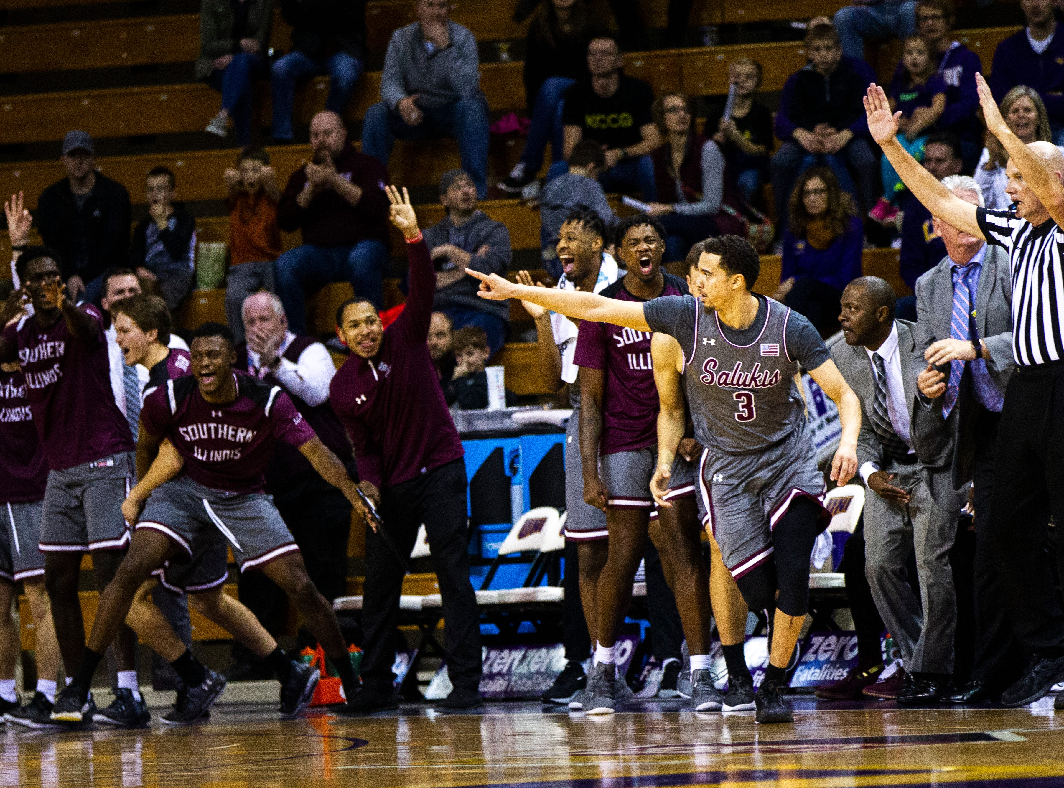 Southern Illinois guard Marcus Bartley (3) celebrates in front of his bench after making a 3-point basket during a NCAA Missouri Valley Conference men's basketball game on Saturday, Jan. 5, 2019, at the McLeod Center in Cedar Falls, Iowa.