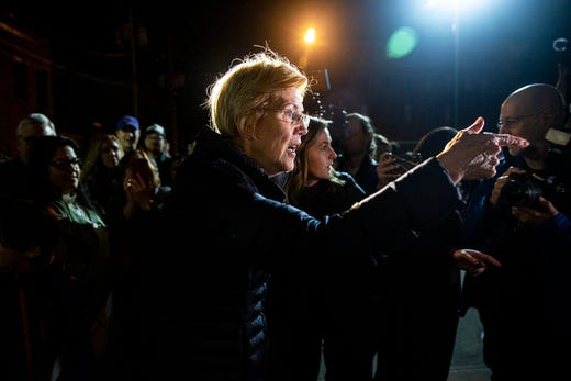 Massachusetts Senator Elizabeth Warren steps outside to talk with the crowd of people who didn't fit inside the East Village venue Curate where she was holding an event, on Saturday, Jan. 5, 2019, in Des Moines. This was her fourth stop out of five she's making in Iowa this weekend.