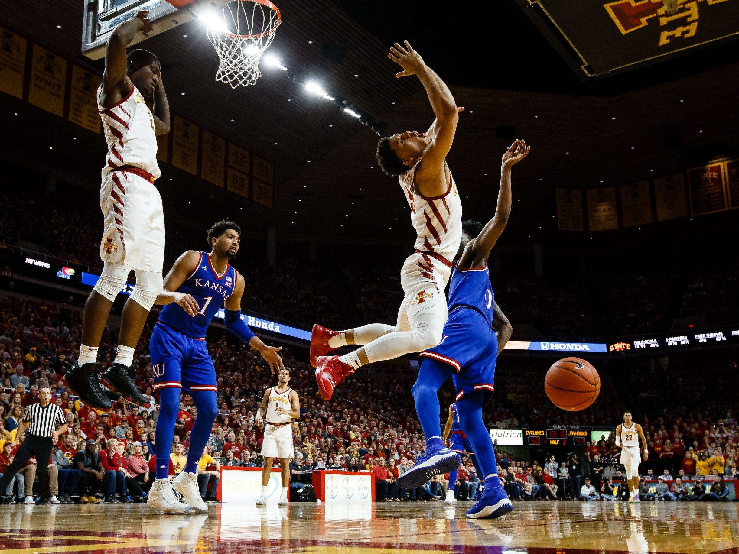 Iowa State's Lindell Wigginton (5) is fouled by Kansas' Marcus Garrett (0) during the second half of their basketball game on Saturday, Jan. 5, 2019, in Ames. Iowa State would go on to beat Kansas 77-60.