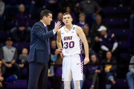 Northern Iowa head coach Ben Jacobson talks with guard Spencer Haldeman (30) during an NCAA Missouri Valley Conference men's basketball game on Saturday, Jan. 5, 2019, at the McLeod Center in Cedar Falls, Iowa.