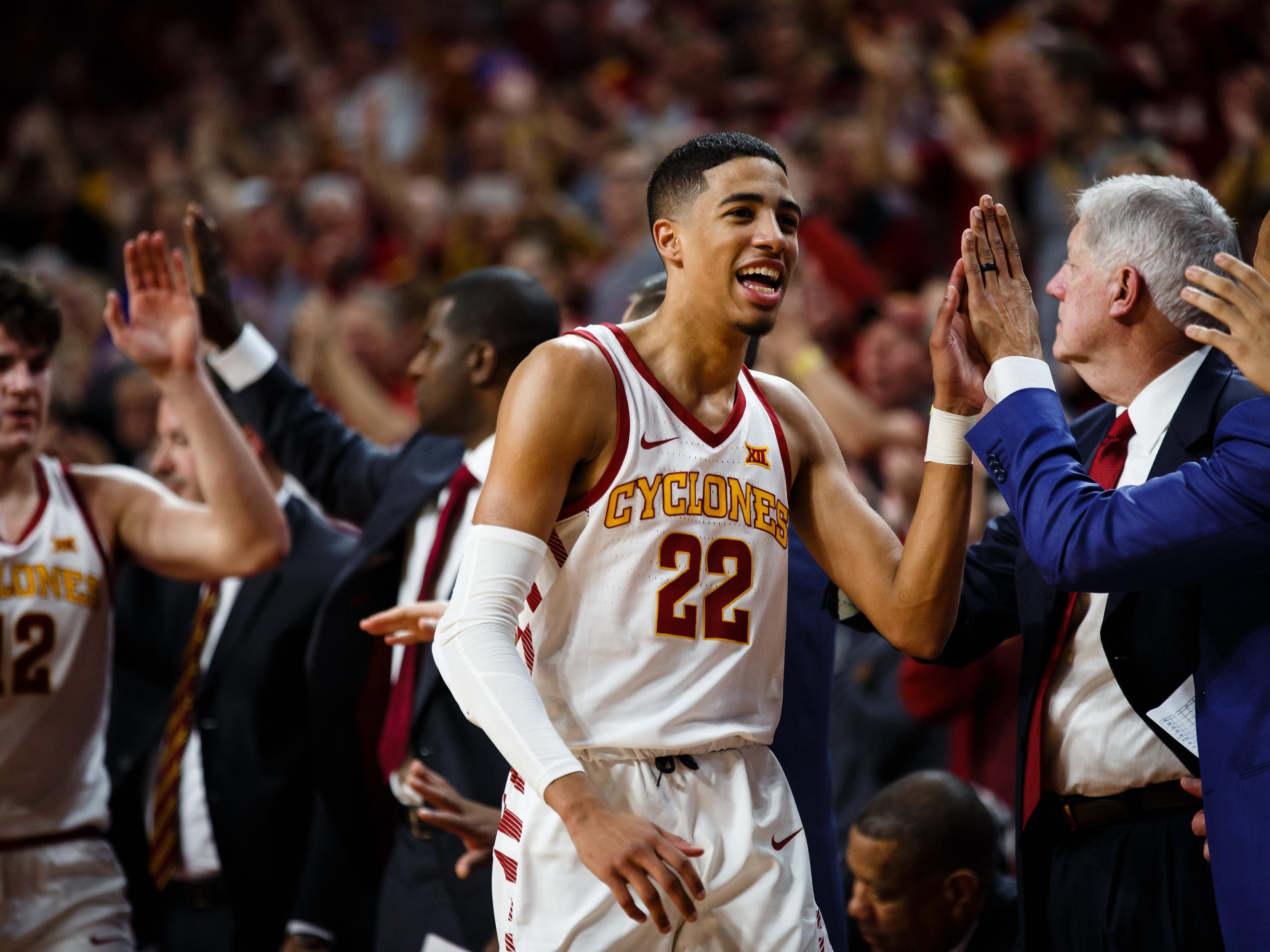 Iowa State's Tyrese Haliburton (22) gets high-fives as he returns to the bench during the second half of their basketball game on Saturday, Jan. 5, 2019, in Ames. Iowa State would go on to beat Kansas 77-60.