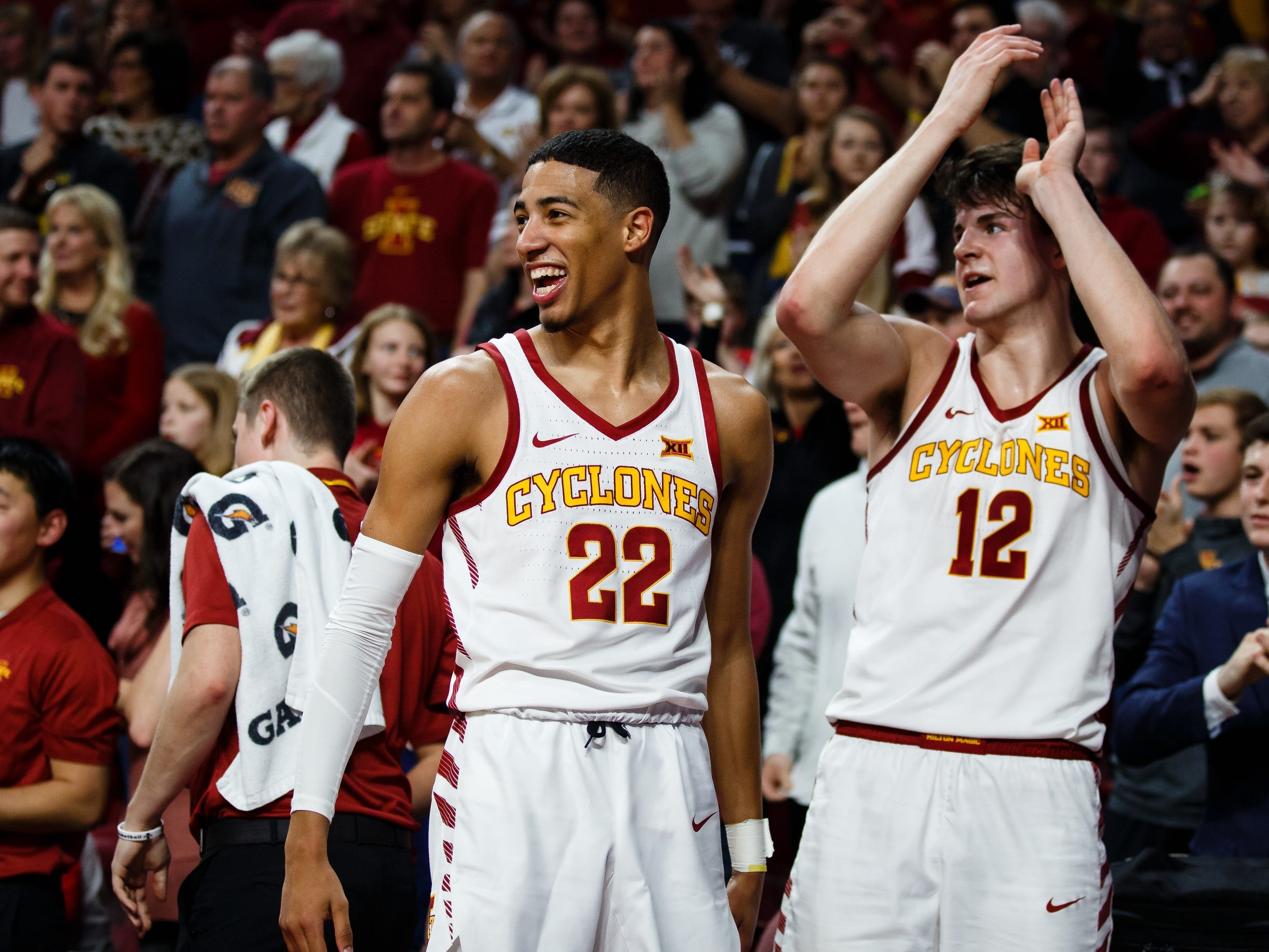 Iowa State's Tyrese Haliburton (22) and Iowa State's Michael Jacobson (12) cheer during the second half of their basketball game on Saturday, Jan. 5, 2019, in Ames. Iowa State would go on to beat Kansas 77-60.