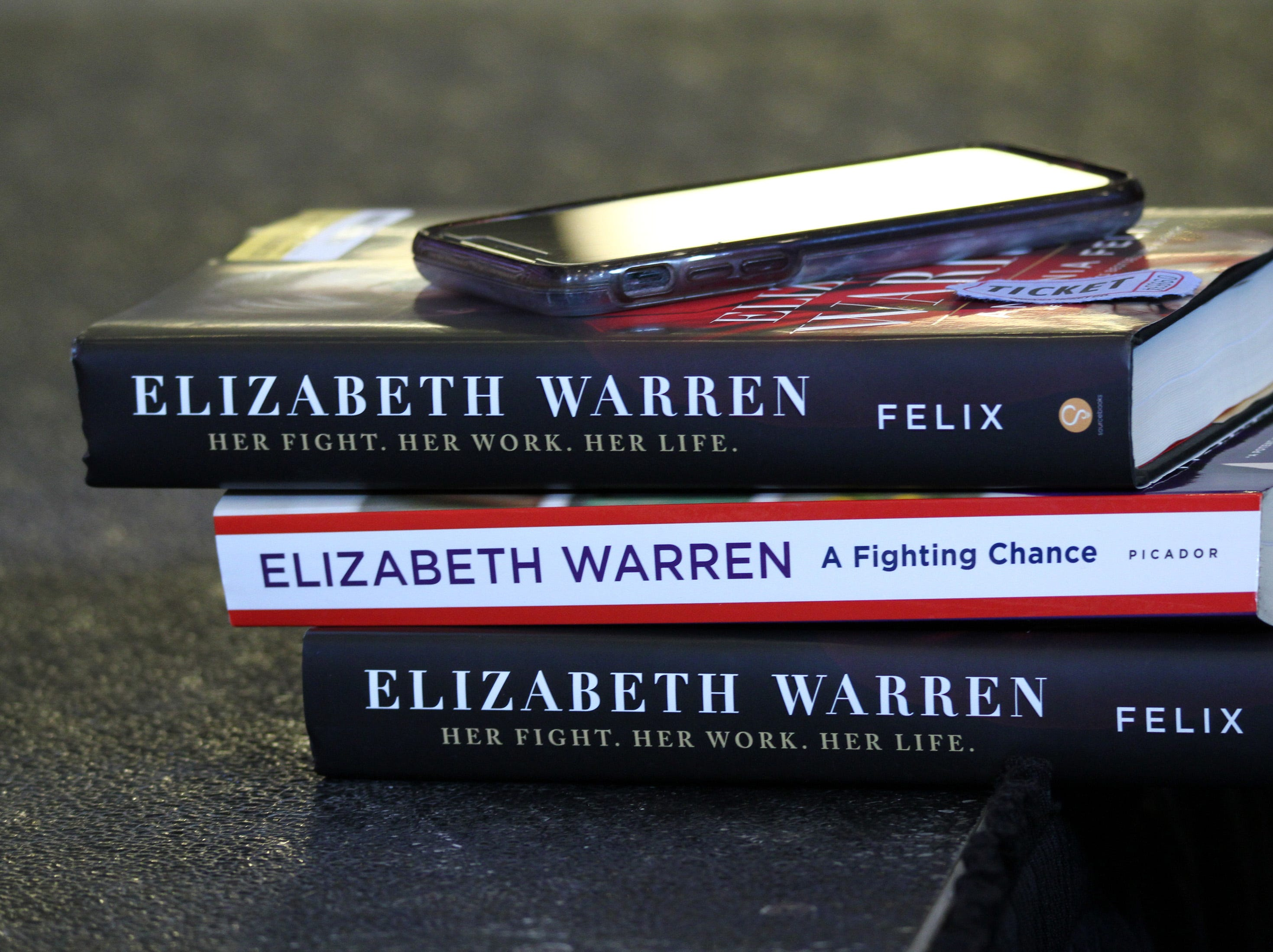 Three books await an autograph by the author as possible presidential candidate U.S. Sen. Elizabeth Warren of Massachusetts visits Iowa and makes a stop for a conversation with women leaders at The District Venue at 1350 SW Vintage Parkway on Sunday, Jan. 6, 2019, in Ankeny.