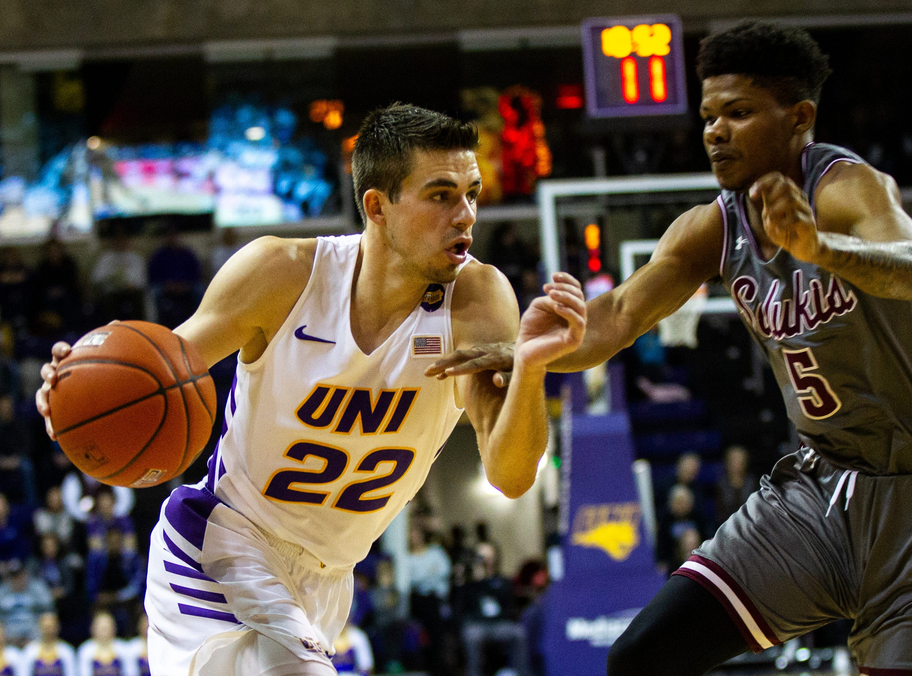 Northern Iowa guard Wyatt Lohaus (22) drives to the basket past Southern Illinois guard Darius Beane (5) during a NCAA Missouri Valley Conference men's basketball game on Saturday, Jan. 5, 2019, at the McLeod Center in Cedar Falls, Iowa.