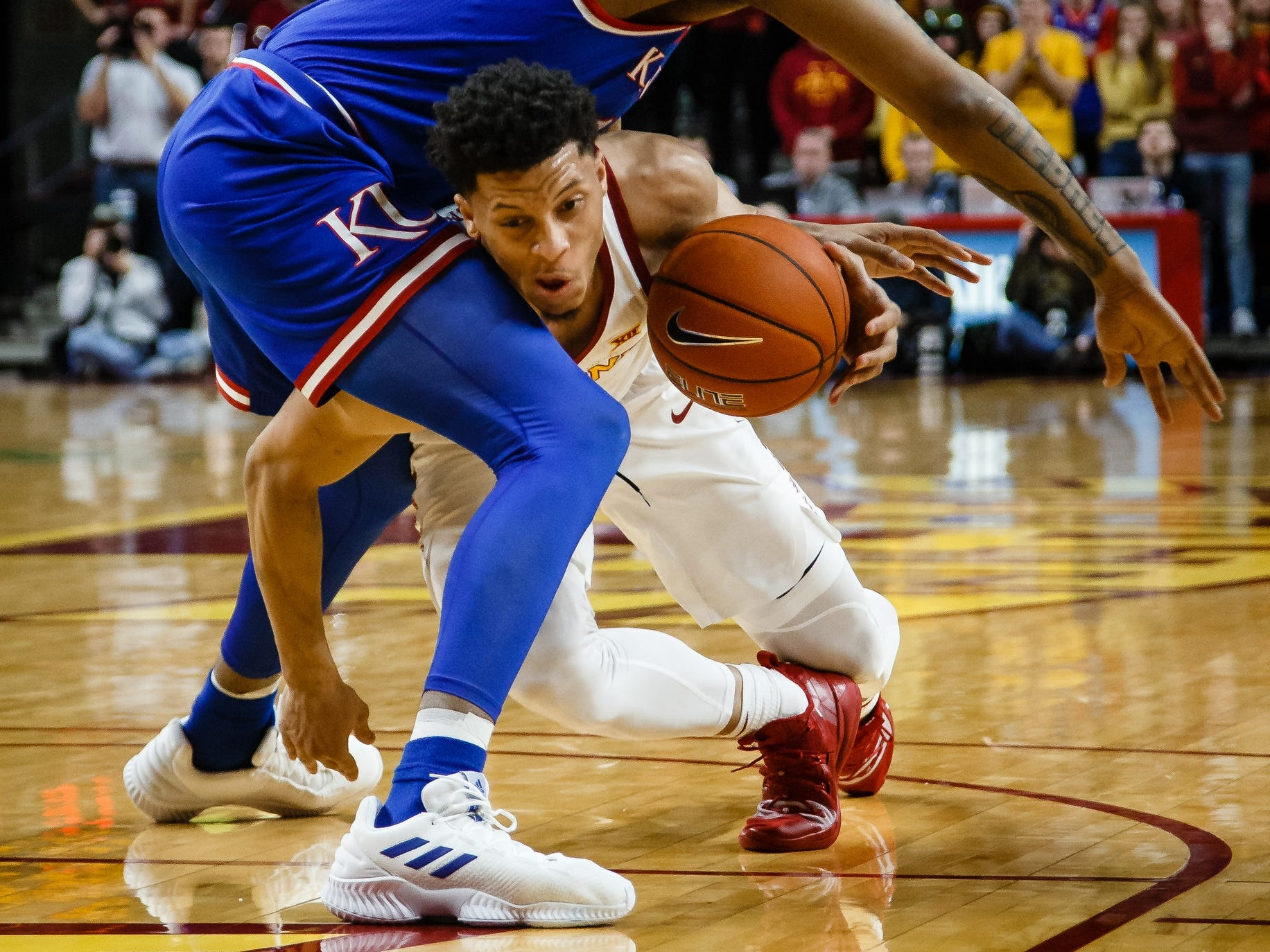 Iowa State's Lindell Wigginton (5) tries to get around Kansas' K.J. Lawson (13) during the second half of their basketball game on Saturday, Jan. 5, 2019, in Ames. Iowa State would go on to beat Kansas 77-60.