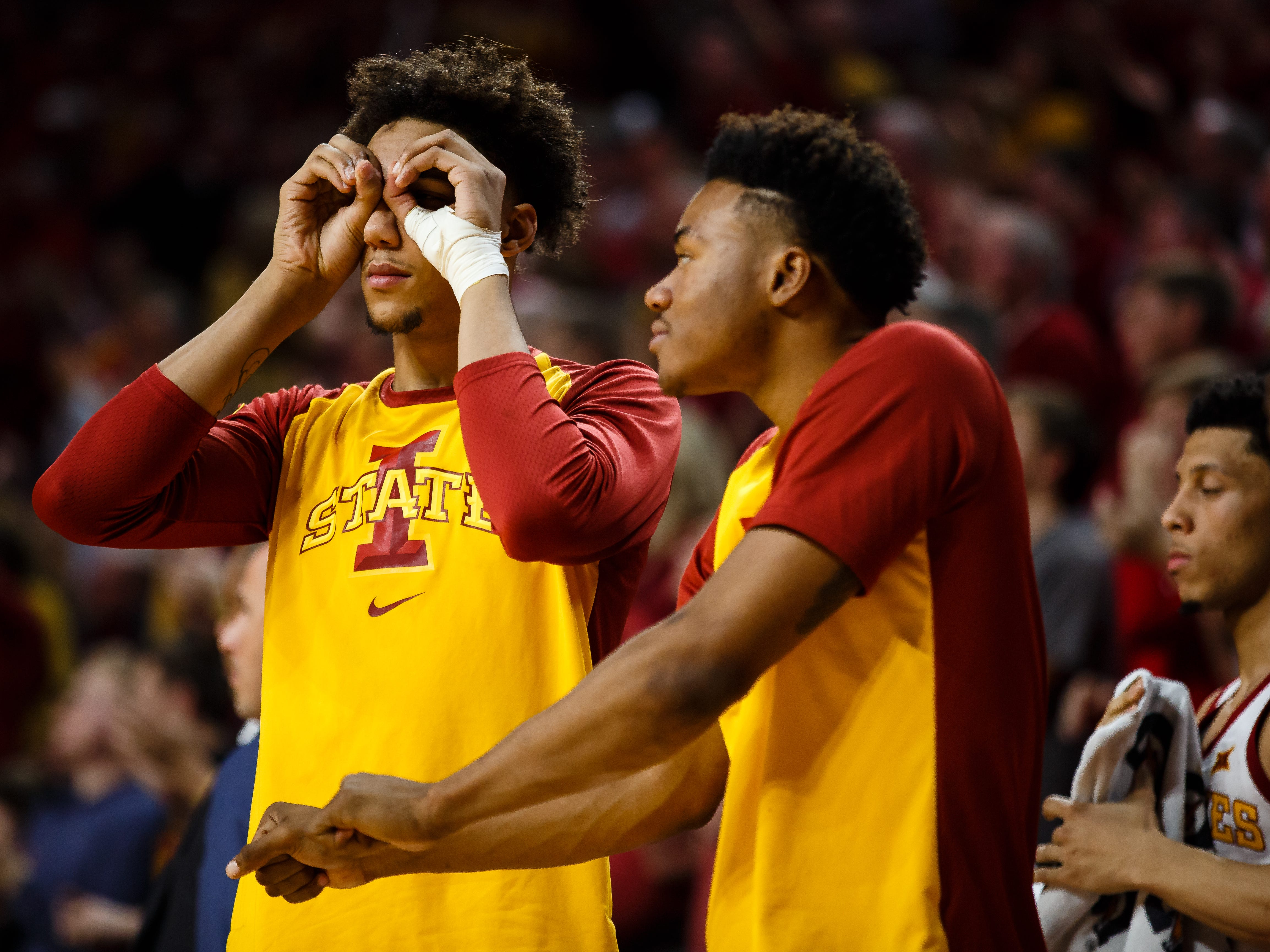 Iowa State's George Conditt IV (4) and Iowa State's Zion Griffin (0) celebrate on the bench during the second half of their basketball game on Saturday, Jan. 5, 2019, in Ames. Iowa State would go on to beat Kansas 77-60.