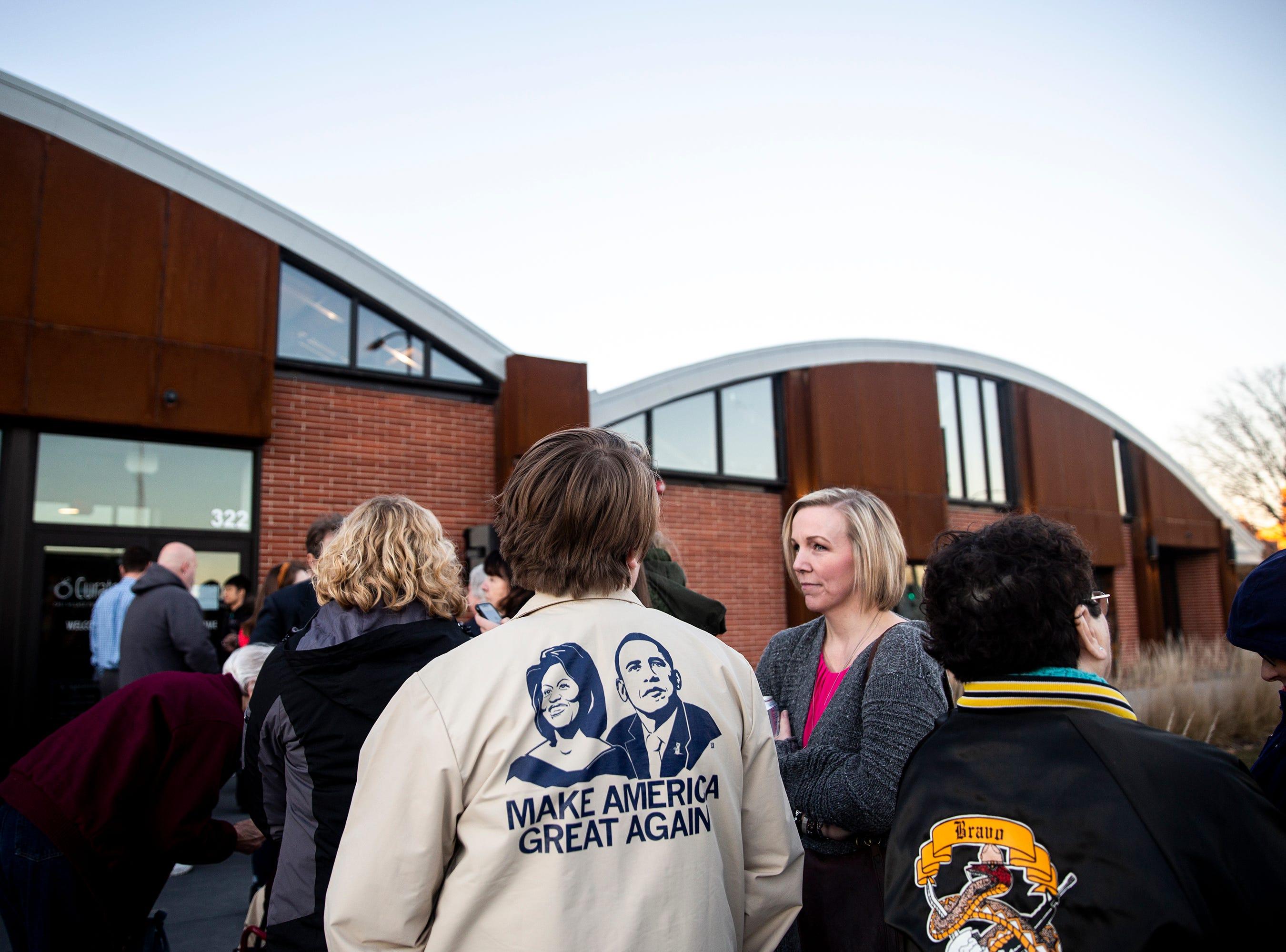 People wait in line to see Elizabeth Warren on Saturday, Jan. 5, 2019, in Des Moines.