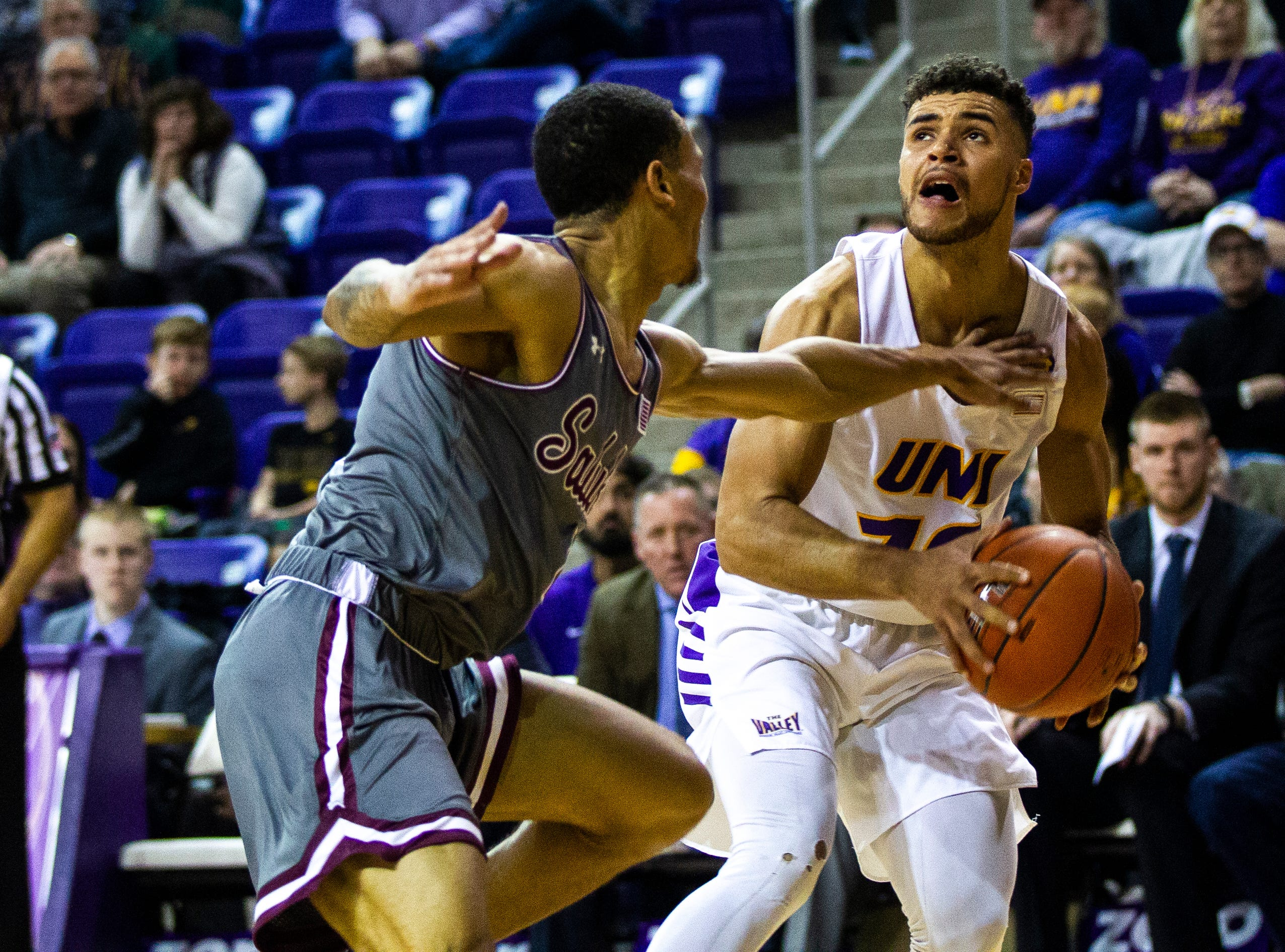 Northern Iowa guard Miles Wentzien (10) gets fouled by Southern Illinois guard Eric McGill (4) during a NCAA Missouri Valley Conference men's basketball game on Saturday, Jan. 5, 2019, at the McLeod Center in Cedar Falls, Iowa.