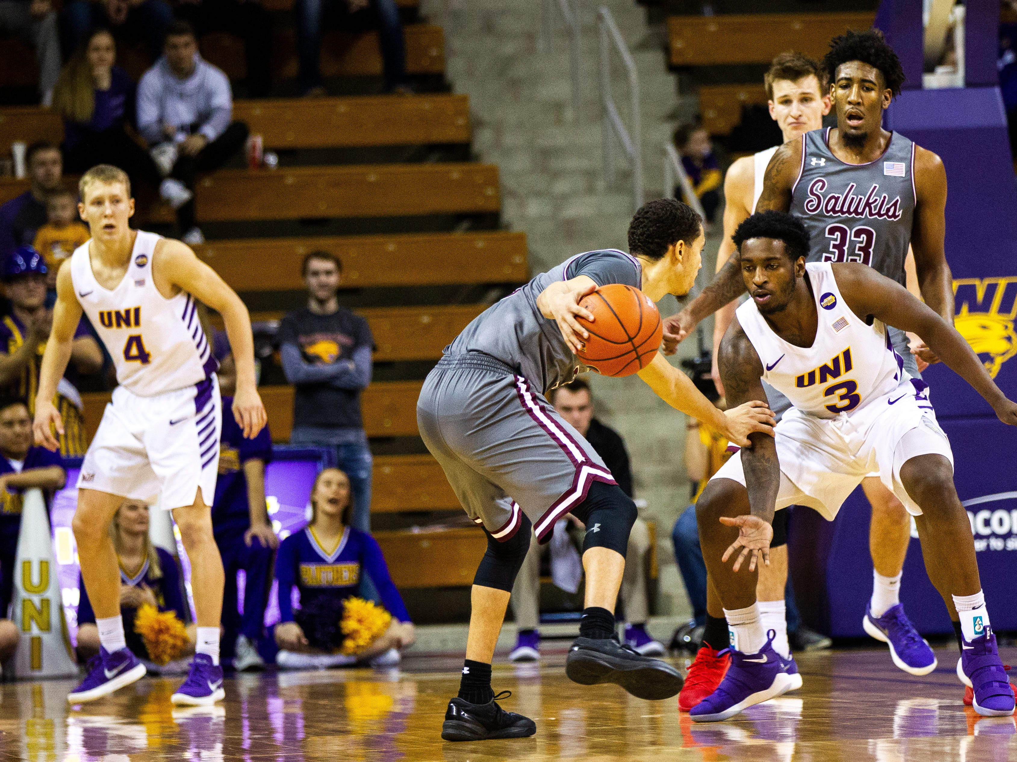 Northern Iowa guard Tywhon Pickford (3) defends Southern Illinois guard Marcus Bartley during a NCAA Missouri Valley Conference men's basketball game on Saturday, Jan. 5, 2019, at the McLeod Center in Cedar Falls, Iowa.