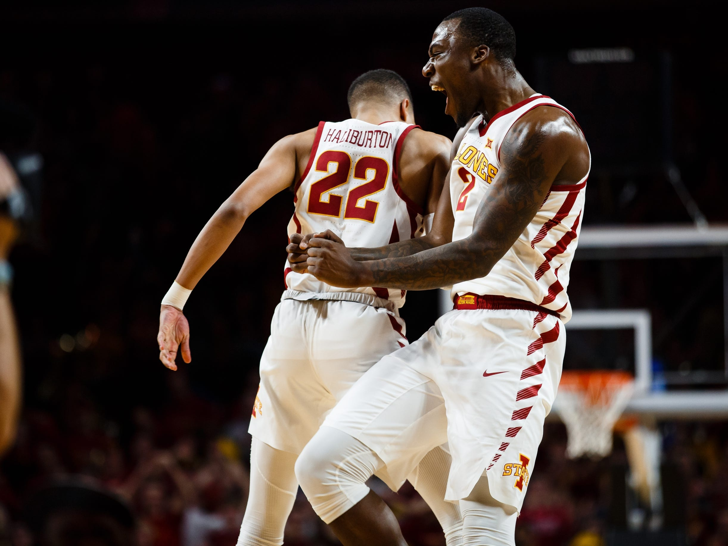 Iowa State's Tyrese Haliburton (22) celebrates with Iowa State's Cameron Lard (2) during the second half of their basketball game on Saturday, Jan. 5, 2019, in Ames. Iowa State would go on to beat Kansas 77-60.