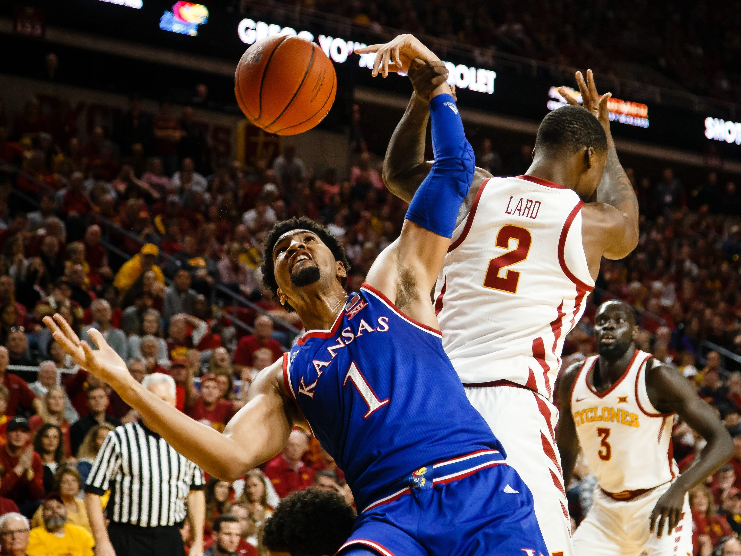 Kansas' Dedric Lawson (1) goes up for a rebound against Iowa State's Cameron Lard (2) and Iowa State's Nick Weiler-Babb (1) during the first half of their basketball game on Saturday, Jan. 5, 2019, in Ames. Iowa State would go on to win 77-60.