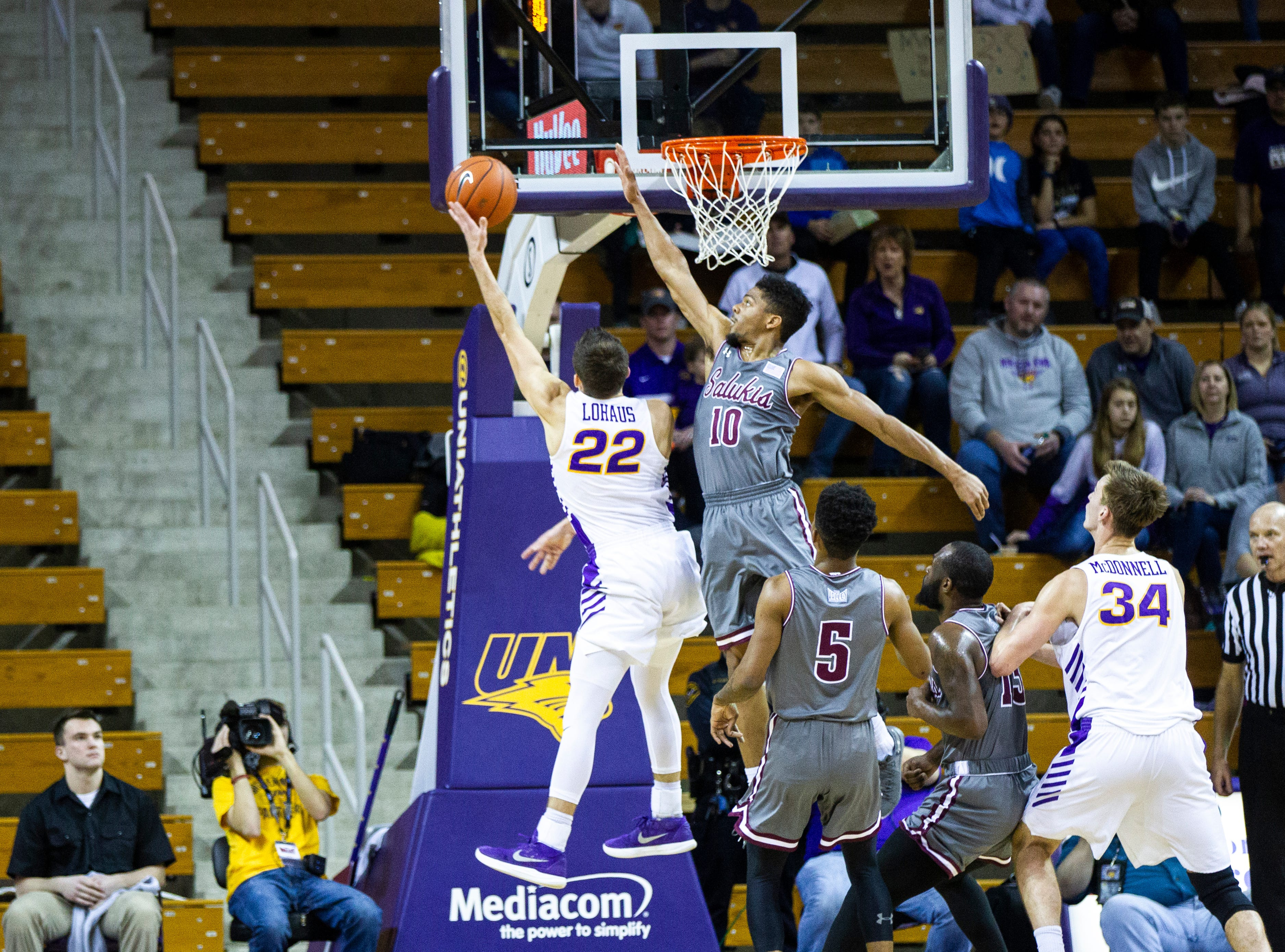 Northern Iowa guard Wyatt Lohaus (22) attempts a layup past Southern Illinois guard Aaron Cook (10) at the end of the first half during a NCAA Missouri Valley Conference men's basketball game on Saturday, Jan. 5, 2019, at the McLeod Center in Cedar Falls, Iowa.
